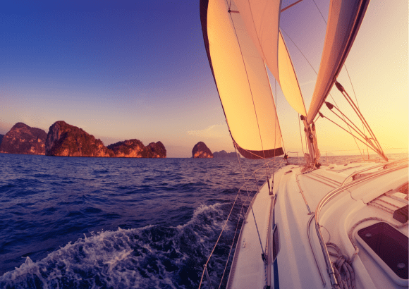 Sunset over the ocean from yacht - retirement planning