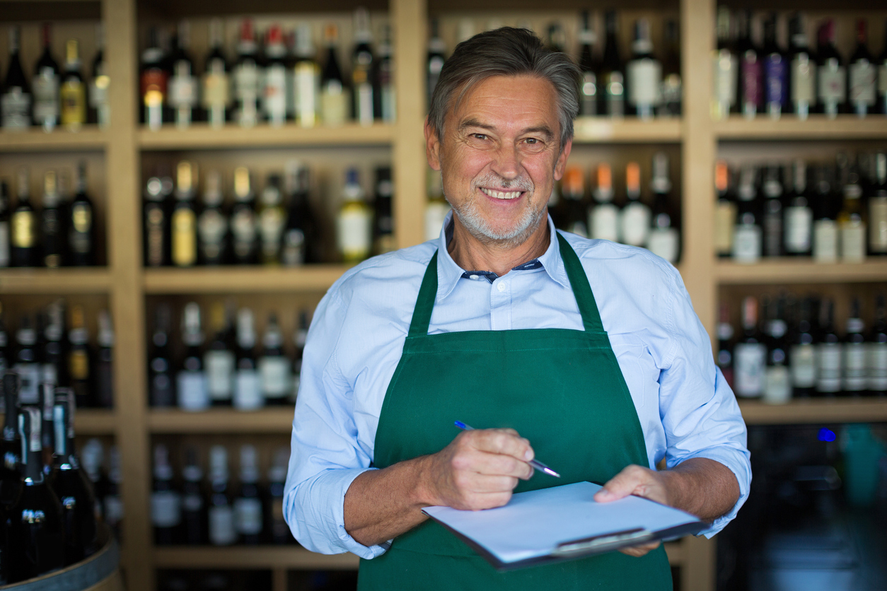 Portrait of sommelier taking inventory in wine store