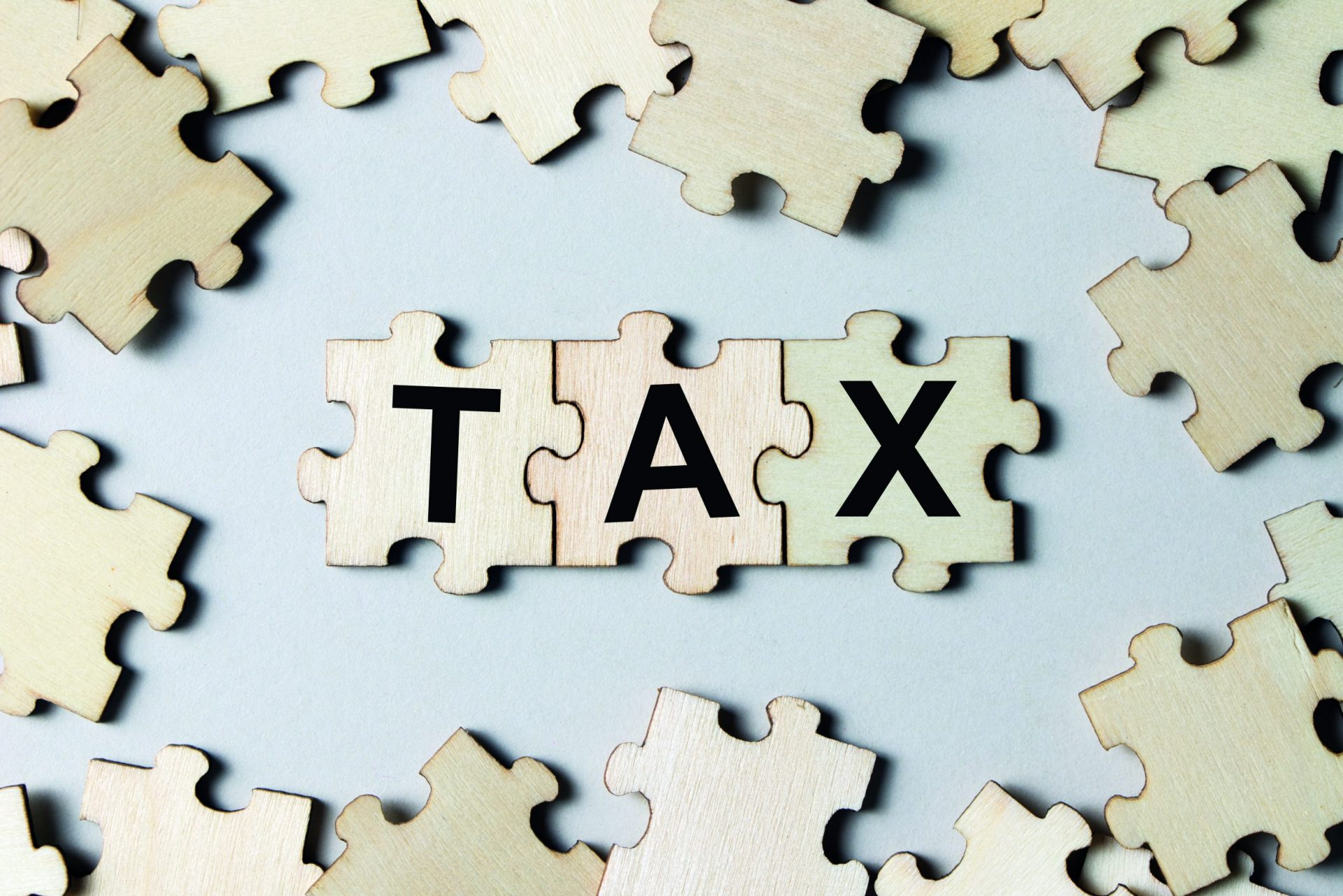 puzzle-pieces-with-word-tax-PZ8AVVN